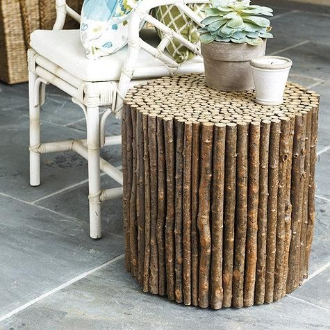 We love this ultra woodsy side table from @Karen Jacot Crump Designs