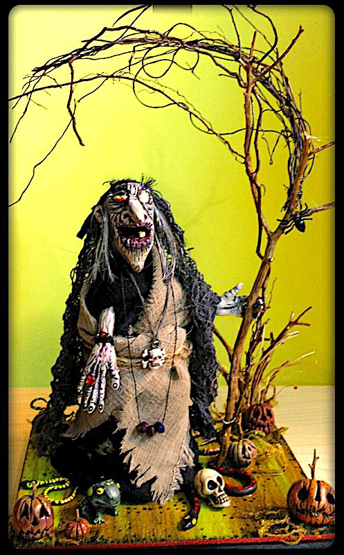 Tadzi, the Ancient Swamp Hag, by Ellie Gee of MacabreWebs Studios 2017 Polymer clays, air dry clay, glitter, acrylic paints, materials/strings/twine, sticks, twigs, moss, wood plank. Hand made!