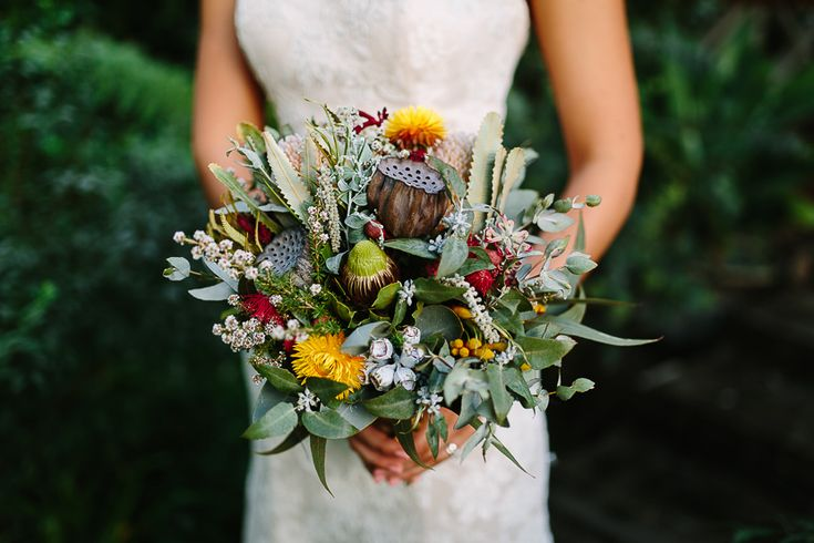 Amazing wedding bouquet of Australian native florals, hand made by the bride herself! | PHOTO CREDIT: Bend Howland - @benhowland