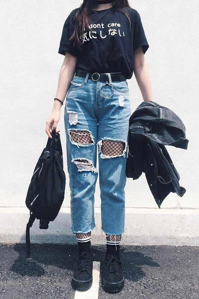 Ripped Jeans With Black Fishnet Tights Underneath #fishnettights #rippedjeans ★ Edgy grunge style from the 90s to inspire your street style. #grunge...