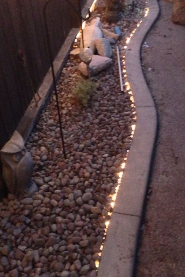 Use rope lights as a bedding border. It's waterproof and inexpensive! Check out Exled's LED rope light range http://www.exled.co.uk/products-by-type/led-rope-light