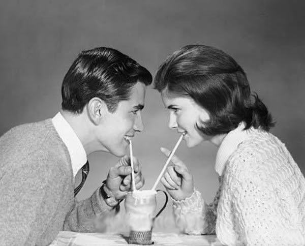 Teenagers sharing a malt. That seemed to be the thing in the 1950's.