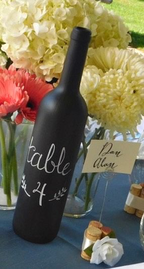 Make a statement with these chalkboard wine bottles!  Perfect for the wine  themed wedding or shabby chic look these wine bottles are covered in  chalkboard paint.  You can use the bottle as table numbers, add flowers and  use as decoration, or centerpieces.Use the chalk included to write the  table number or menu on the bottle.  Leave them blank and put chalk pens on  the tables to let your guests write you notes that you can later display  around your home.  If you prefer not to write on…