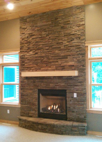 ove stone around the fire place. doesnt have to be built in. DIY with.  Stacked Rock FireplaceRock FireplacesStacked Stone ...