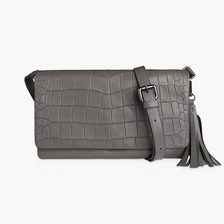 EMILY - GREY, FLAT CROC. Emily will carry all your essentials for a good night out or a stylish lunch date. It features a small pocket on the inside and locks with a hidden magnet.