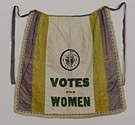 Votes for Women apron sold by the English organization, the Women's Social and Political Union. The clarion image was designed by Sylvia Pankhurst, daughter of WSPU founder, Emmeline Pankhurst.