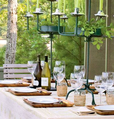 outdoor picnic ideas | Wooden trays and woven cup holders balance the dramatic candelabras on ...