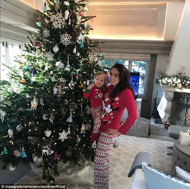 Festive feeling: Tamara Ecclestone shared a cute snap of her and her two-year-old daughter Sophia dressed in matching Disney pyjamas as they settled into their Christmas break away to the Swiss Alps on Friday