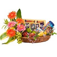 Flowers with Fruits Basket – A combination of fruits  a) 2kg like apples, bananas, grapes etc with  b) assorted Cadbury chocolates and  c) Horlicks beautifully decorated in a bamboo basket with Gerberas.