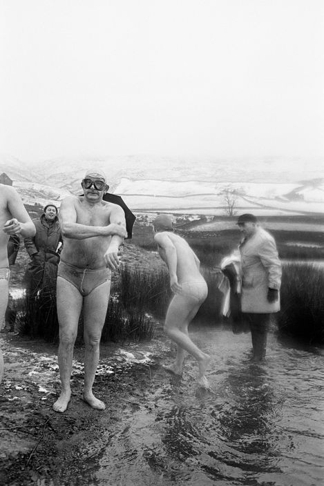 Martin Parr GB. England. West Yorkshire. Todmorden. Lee Dam Swim. Johnny O' Hara (front) and Percy Bull (right) broke the ice to allow swim to take place. January 1976.