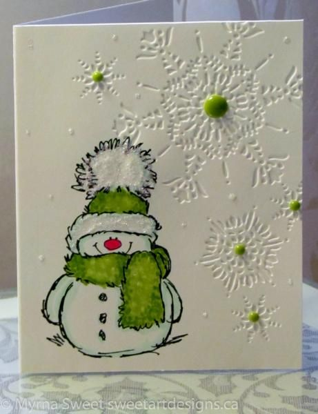 Snowy the stamp and Flurry the embossing folder form the basis for this handmade Christmas card. Frosted Stickles add fluff to the hat and enamel dots add some punch to each snowflake.