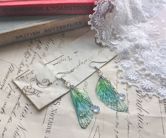 Rather pretty Small  Blue Faerie wing earrings by UndertheIvy2
