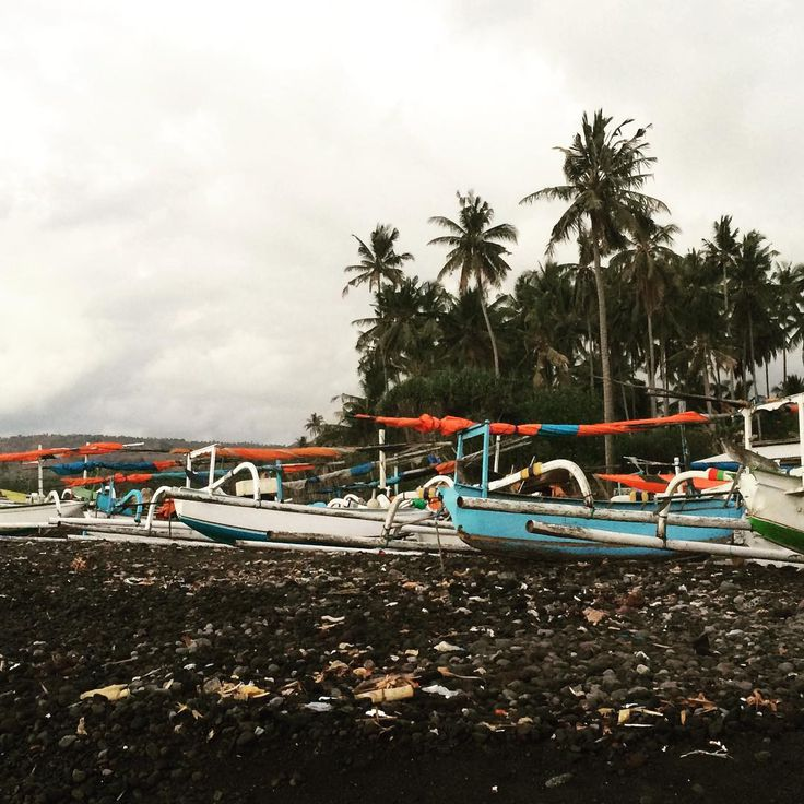 Traditional fishing boats called jukung line almost every beach in Bali.