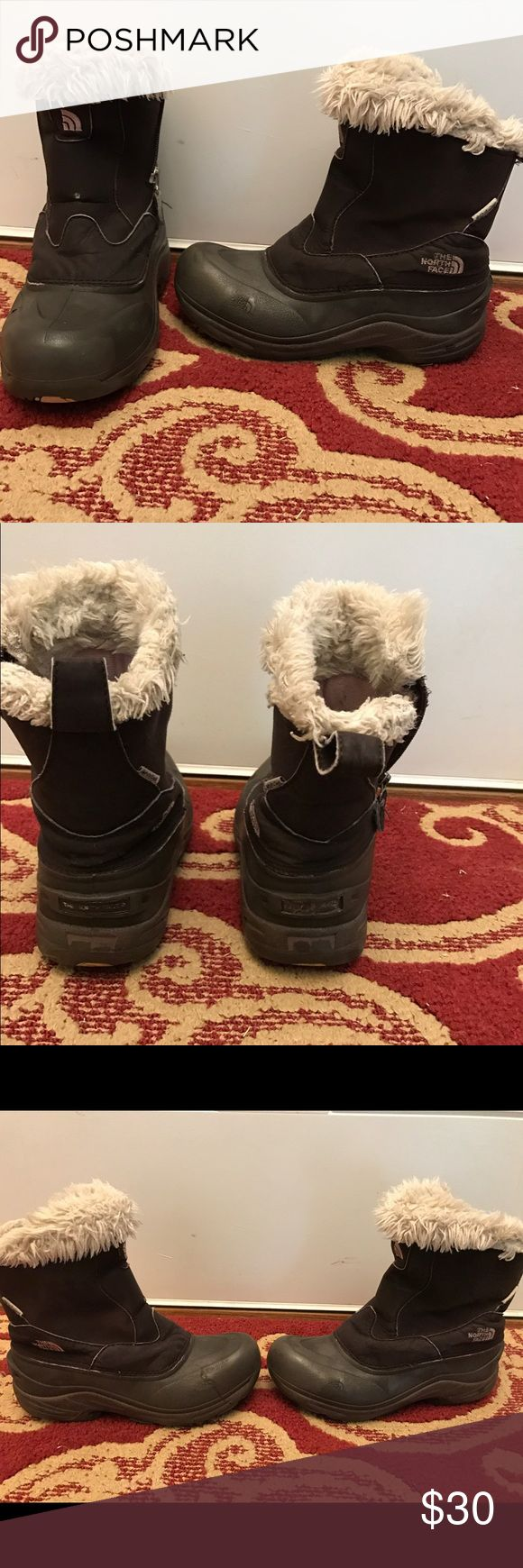 North Face Boots size 4 🎀offers welcome🎀 Great pair of extremely warm North Face boots. Girls size 4. Left boot has small indent of the North Face logo on Bolton of shoe. Smoke free home.  Next day shipping. Please feel free to ask any questions. Thank you for shopping my closet. Offers always welcome❤️ North Face Shoes Rain & Snow Boots