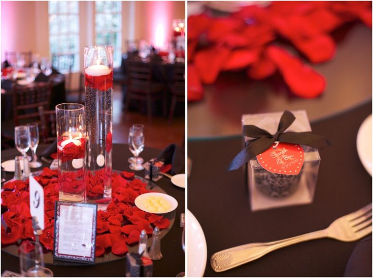 elegant table decor :: candles in tall glass vases and red rose petals on black table cloths - #weddingcolors #blackandred - high grove wedding reception - southern wedding photographers, raleigh nc