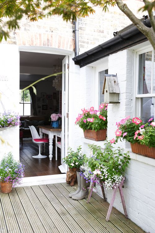 "Sneak Peek: A London Home Filled with Travel Finds. ""I'm a bit retro in my love of petunias and lobelia!"" #sneakpeek"