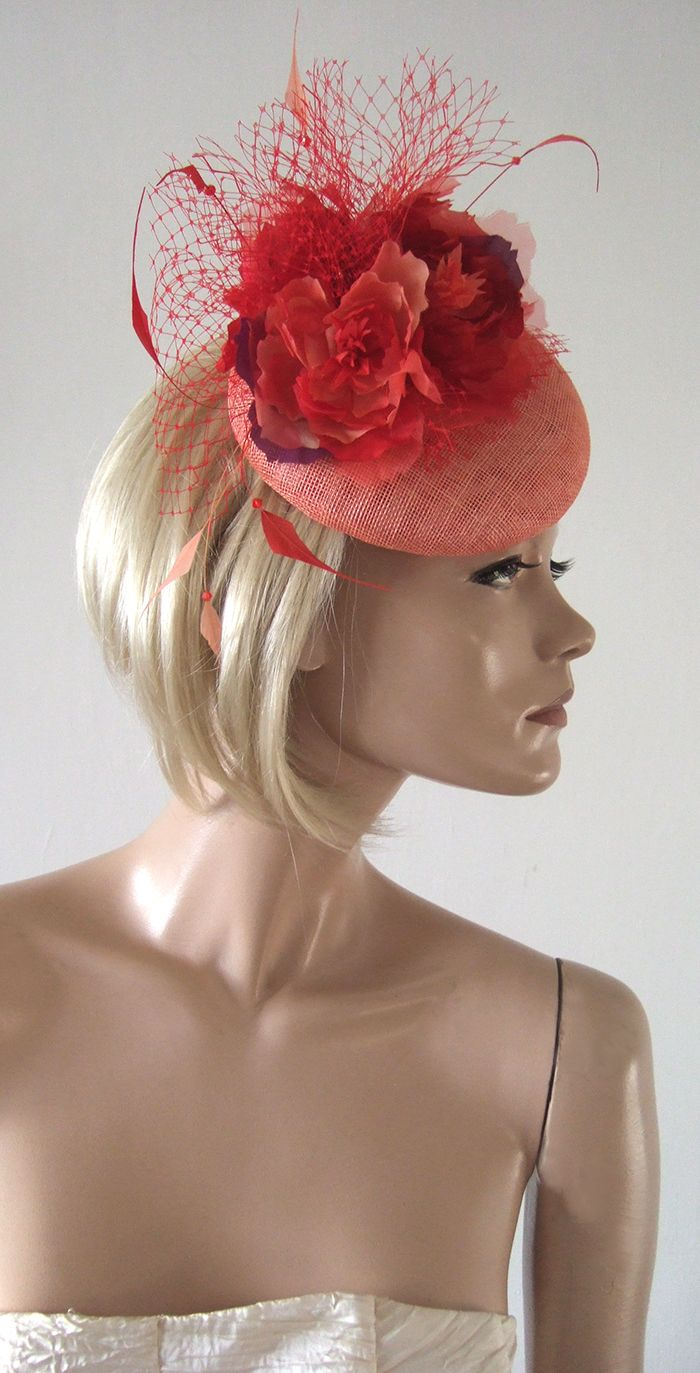 62ca3056 Living Coral Fascinator. Living coral with deeper coral red and purple  flowers. In the ladies hat hire collection. Available for wedding guests,  ...