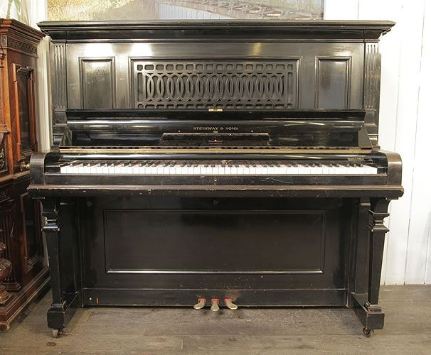 """A rare 1918, Steinway Model R upright grand piano with a black case and cut-out front panel at Besbrode Pianos. Piano has an eighty-eight note keyboard and three pedals. The Steinway Model R was designed around 1900. It is larger than the Model K and has the """"Upright Grand String Frame"""" with """"Capo d'astro Bar"""" stamp on the frame. The Steinway Model R was only made in the Hamburg factory. Production in Hamburg of the Model R was discontinued in 1942 Interestingly, two Steinway Model R…"""