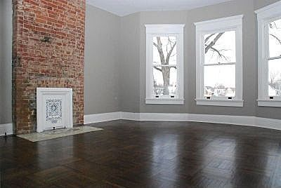 Master Bedroom Renovation Inspiration: color pallet. Exposed red brick, grey walls, white trim, dark floor. Navy accents.