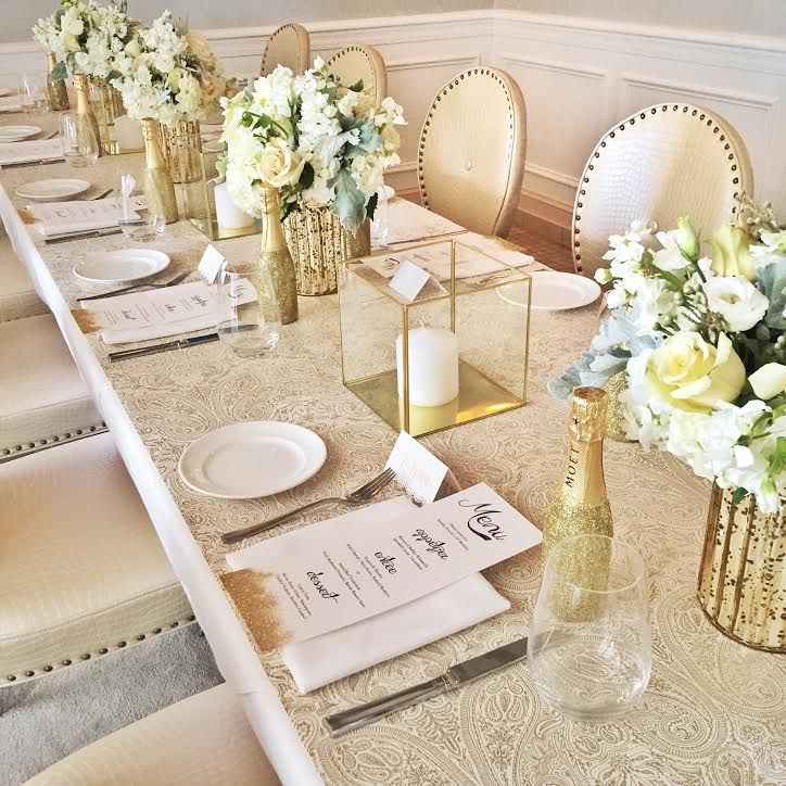 Gold and White Table Setting by Libby Living Colorfully Gold Glitter Moet Champagne Bottles as Party Favors and BHLDN decor