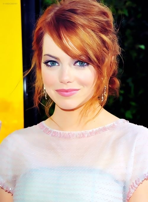 Hair color, lip color, and clothes makes her blue eyes pop.