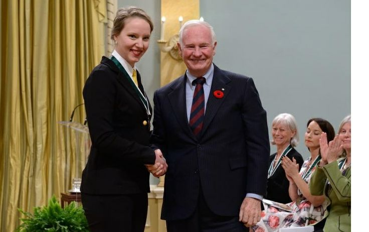 This is a photo of Julie Lalonde--a recent Carleton graduate--receiving an award from the Governor General for her activism. Among other things, Julie was one of the leaders of the struggle to establish a student-run Sexual Assault Support Centre on campus and is the coordinator of the Carleton Sexual Assault Support Line. -Peter H.