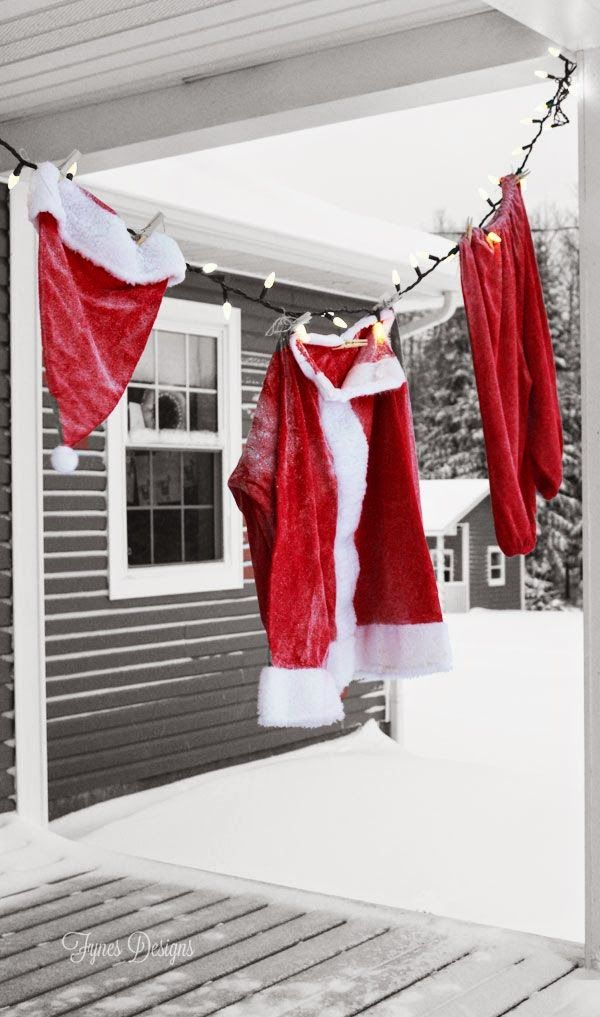 Hang a Christmas Santa Suit from a string of lights Outdoor Christmas decoration
