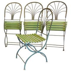 Art Deco Period Folding Garden Chairs, Stylized Palm Trees, Set of Four | From a unique collection of antique and modern garden furniture at https://www.1stdibs.com/furniture/building-garden/garden-furniture/