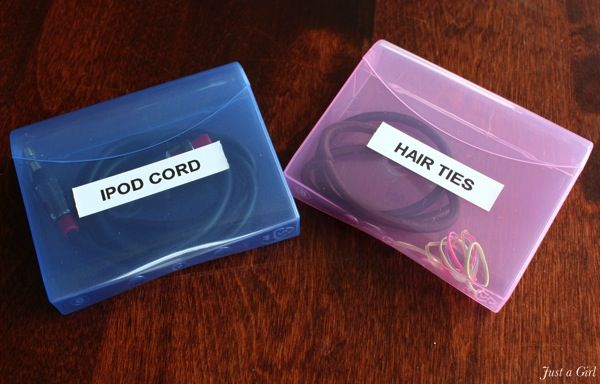 Q-tip cased for storing items - this will be great for hair rubber bands to keep in the car (always forget for 'nastics)