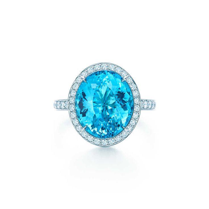 Tiffany & Co. -  Esteemed Blue CuprianElbaite Tourmaline Ring: A ring of white diamonds frames a blue cuprian elbaite tourmaline of esteemed origin set in platinum. Carat weight: blue tourmaline, 5.47. Carat total weight: round brilliant diamonds, 1.02; princess-cut diamonds, .36.
