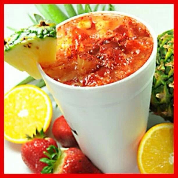 Rusa Twist Crushed Ice Toronja (grapefruit) soda chopped Strawberries chopped Orange chopped Pineapple Chamoy Chilito