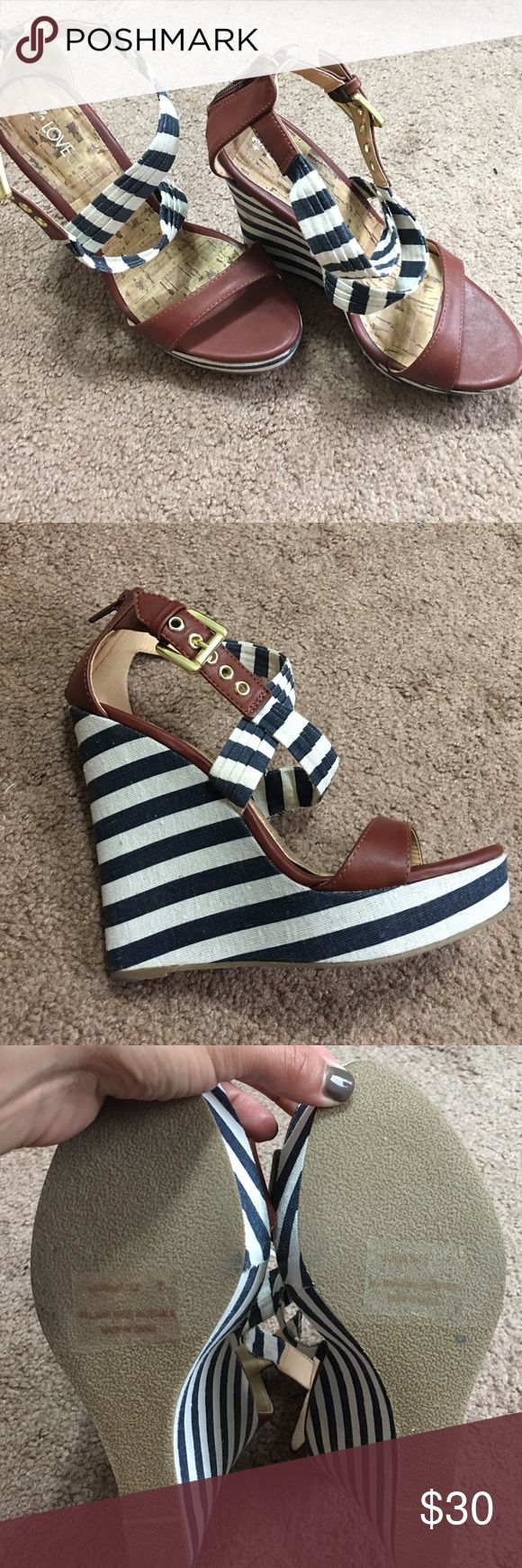 Blue and White Stripe Wedges New without tags wedges. I only tried them on inside. Purchased on poshmark boutique, but never got around to wearing them. They are super cute and run true to size. There is some discoloration on the inside of one of the straps as noted in the picture, but can't been seen when wearing them. Love Culture Shoes Wedges