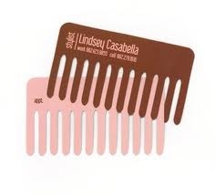 Die cut comb business card.  I know a few hairdressers that would love this!
