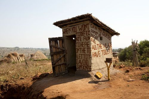"One of the first latrines in Venceremos (""We will overcome"") village in Mozambique,"