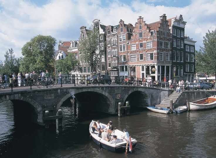 my own country can be beautiful too if you look at this picture, this is Amsterdam :D I live in The Netherlands and I'm proud of it ♥