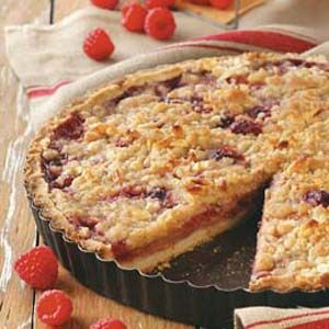 Raspberry Pear Tart Recipe -Fetch the forks! Guests will be eager to dig into this festive tart. Destined to become a favorite holiday dessert, it looks and smells as delightful as it tastes. —Bernice V. Janowski, Stevens Point, Wisconsin