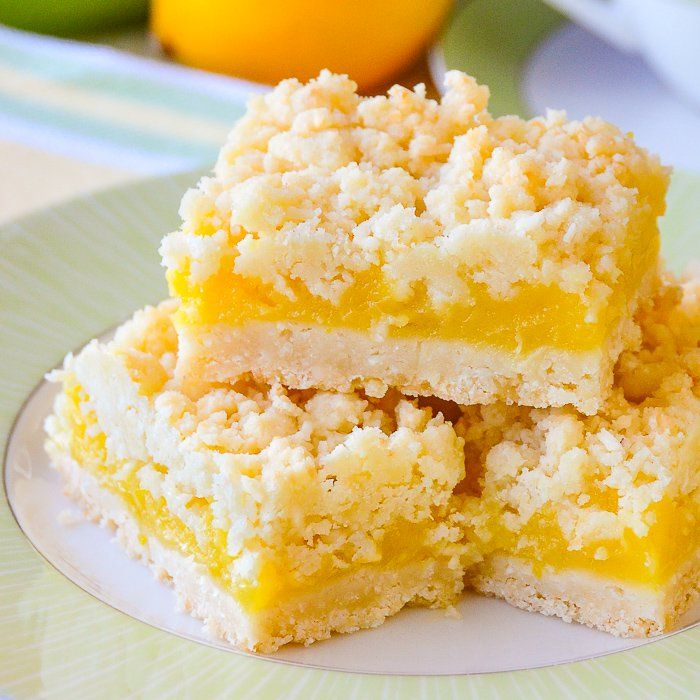 Coconut Lemon Crumble Bars. A 35+ year old family recipe that combines coconut and tangy lemon filling in a buttery crumble bar cookie. Freezes quite well too. #CookieBars