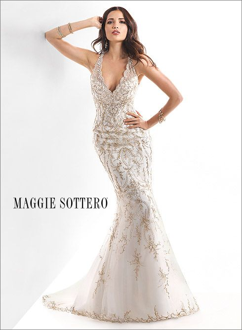 Lavish embroidery and sparkling beads adorn Blakely, this stunning fit and flare gown, shown in Ivory/Gold Accent.