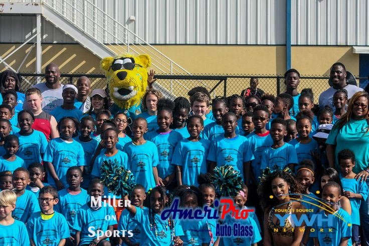 """Malik's Gifts  brought Cliff Avril, Sheldon Day, AJ Cann, Jaxson De Ville, Some Jacksonville Jaguars Players and Cheerleaders and some of their other friends out to University Christian School today for the Malik Jackson & Friends host """"A Night of Giving"""" Youth Football & Soccer Program Camp."""