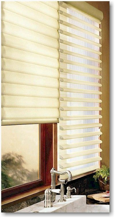 Beautiful and versatile Roman Shades with a view, Hunter Douglas Pirouette® window shadings offer an innovative window treatment solution for a kitchen. ♦ Hunter Douglas window treatments