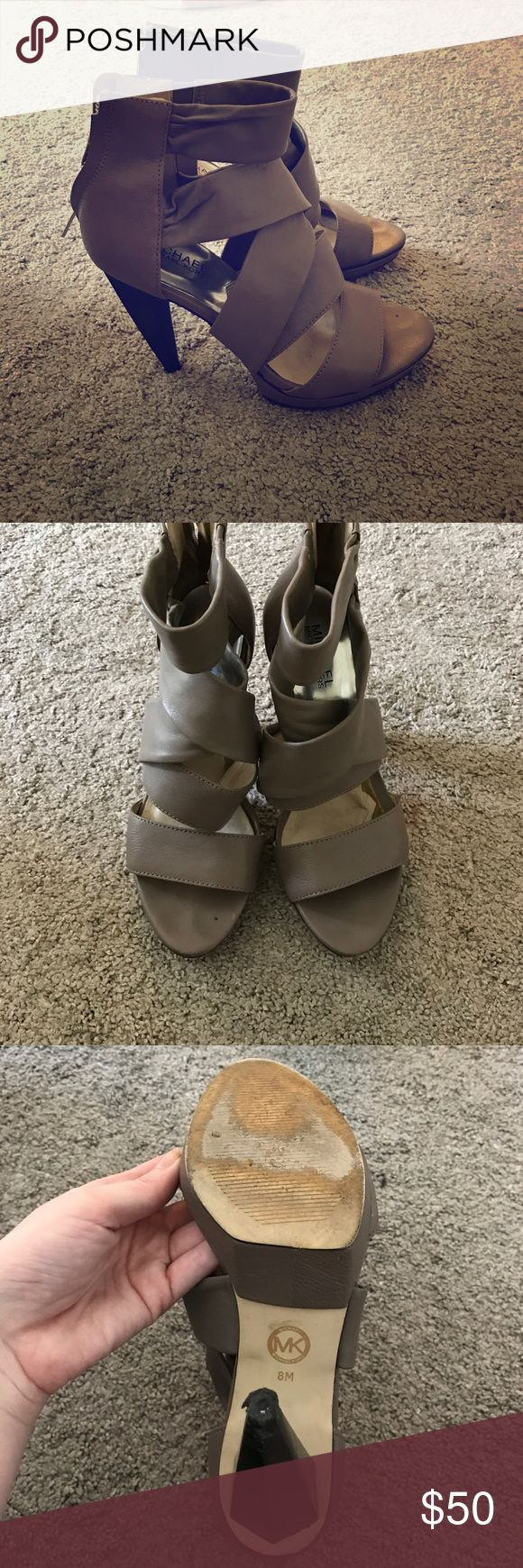 Michael Michael kors straps heels Beige strappy heels. Michael Michael Kors brand. Some wear and tear. Material is starting to peel at the ball of the foot but can be easily fixed. Can't see it when your foot is in them! Leather material. 4 inch heel MICHAEL Michael Kors Shoes Heels