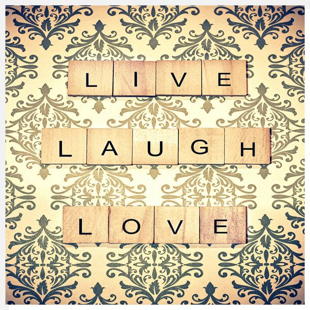 Live Laugh Love  Some nice wallpaper and old scrabbled tiles.