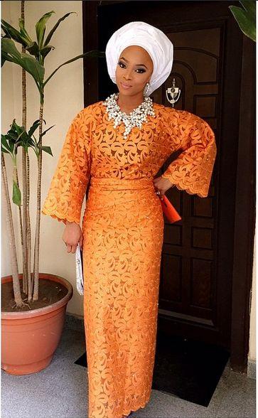 Orange Nigerian weddings. White gele. Top skirt/dress. Bride inspiration. aso oke. white bead necklace