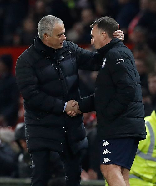 Manchester United manager Jose Mourinho and Wigan Athletic manager Warren Joyce shake hands after the final whistle during the Emirates FA Cup Fourth...