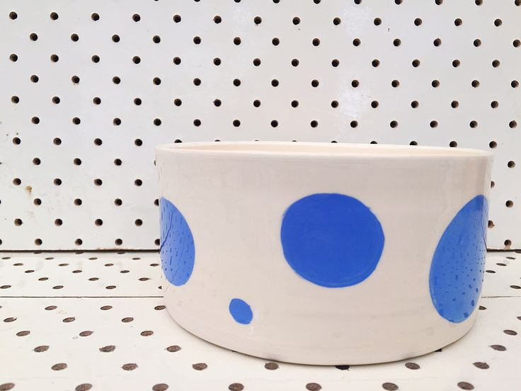 This Handthrown Earthenware serving bowl measures 14.5cm in diameter x 7cm tall.It has been hand decorated and glazed and then sealed with Liquid Quartz making it food safe.It is sold individually but matches the Blue Polka dot coffee bowls and Tumblers in this range.