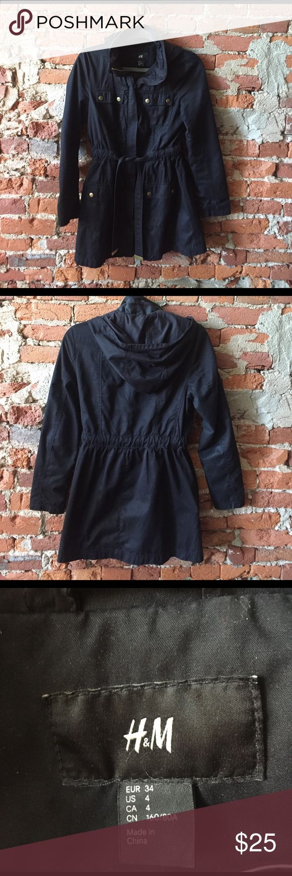 Black H&M trench coat with hood Black H&M trench coat with hood. Great light spring or fall jacket, hits mid-thigh. Cute gold zippers and buttons. Has a flattering tie around the waist. Size 4. H&M Jackets & Coats