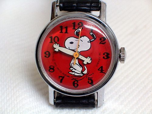 Vintage Snoopy Character Watch by Timex, Manual Wind, Peanuts Gang Characterr Family, Measures 25 mm x 32 mm, Circa 1974.