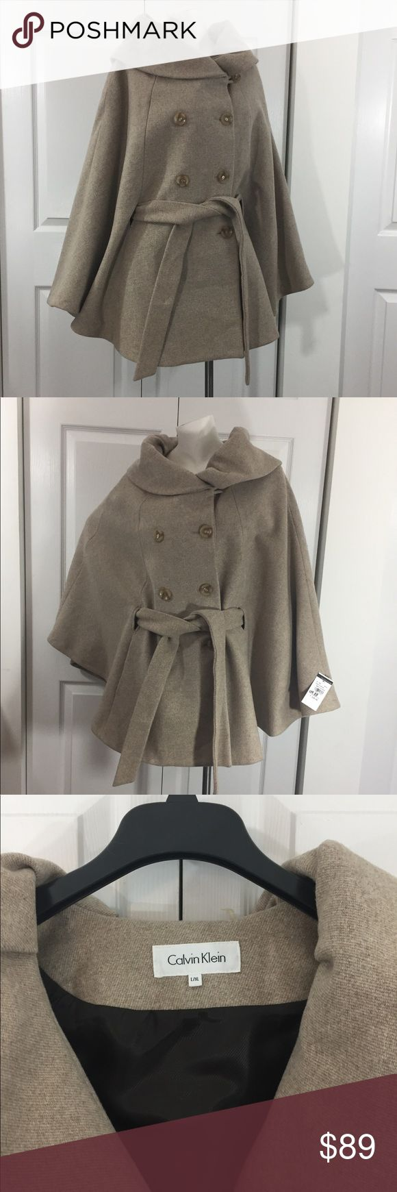 """CALVIN KLEIN Wool Blend Cape Calvin Klein Cape.  Tan with a double breasted look. 4 button front closure with tie belt.  2 front pockets.  Size L / XL.  Approx. 51"""" across x 32"""" long.  60% wool, 35% polyester, 5% other.  Never worn, tags attached. Calvin Klein Jackets & Coats Capes"""