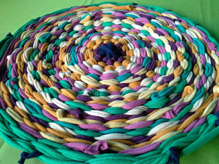 T-shirts have been woven into a rug.