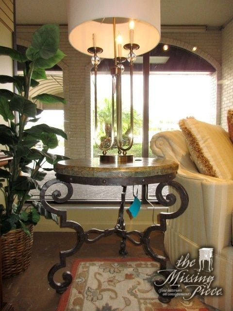 """Dark marble top end table on curved metal legs. There is a cord cutout in the top for placing a table lamp on top. Beautiful! Measures 26""""round x 25""""high. At posting, we have two and the matching coffee table."""